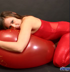 Babe In Tight Red Outfit Playing With Huge Balloon - Picture 9